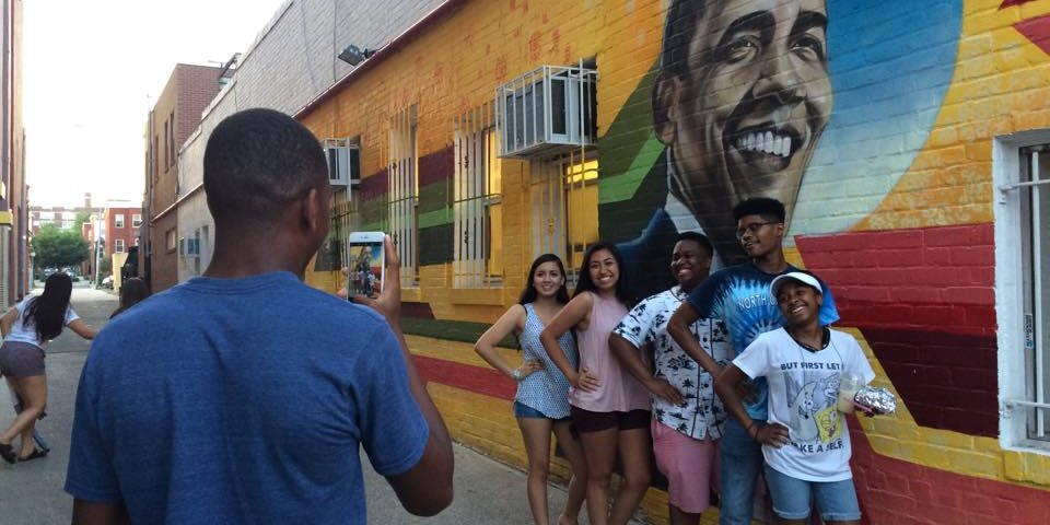 Student U Students pose in front of mural of Former President Barack Obama in Durham, NC.